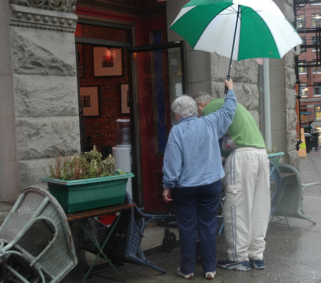 Elderly couple under umbrella