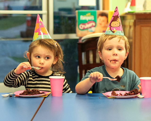 Little boy and girl eating cake