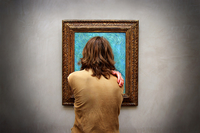Man viewing Van Gogh painting